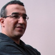 """<a class=""""pum-trigger  popmake-806"""" data-do-default="""""""" style=""""cursor: pointer;"""">Prof. Aziz Bensalah</a>"""